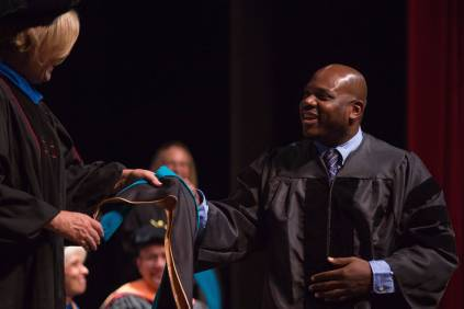 Dr. Allen Patmon is hooded for an Occupational Therapy Doctorate during the Brenau University College of Health Sciences Graduate Hooding Ceremony on Thursday, May 5, 2016. (AJ Reynolds/Brenau University)