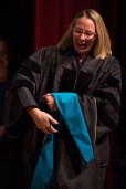 Dr. Sara Propes walks across the stage to be hooded as an Occupational Therapy Doctorate during the Brenau University College of Health Sciences Graduate Hooding Ceremony on Thursday, May 5, 2016. (AJ Reynolds/Brenau University)