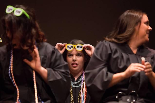 Meg Bronaugh wears 'Class of 2016' sunglasses during the Brenau University School of Nursing Pinning Ceremony on Thursday, May 5, 2016 in Pearce Auditorium in Gainesville, Ga. (AJ Reynolds/Brenau University)