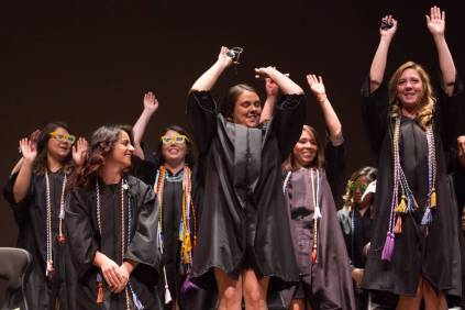 Students do the wave during the Brenau University School of Nursing Pinning Ceremony on Thursday, May 5, 2016 in Pearce Auditorium in Gainesville, Ga. (AJ Reynolds/Brenau University)