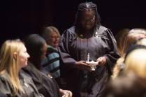 Fabienne McDonald walks back to her seat after receiving her lamp during the Brenau University School of Nursing Pinning Ceremony on Thursday, May 5, 2016 in Pearce Auditorium in Gainesville, Ga. (AJ Reynolds/Brenau University)