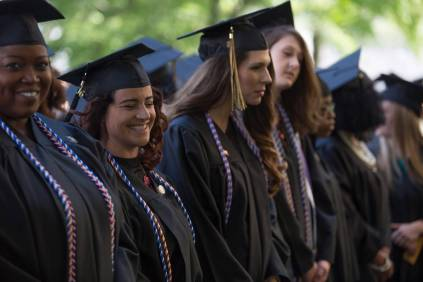 Shimi Barry, left, and Courtney Voss, both WC '16, laugh during The Women's College Commencement on Friday, May 6, 2016, in Gainesville, Ga. (AJ Reynolds/Brenau University)
