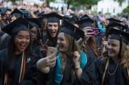 Graduates pose for photos after flipping their tassels during The Women's College commencement on Friday, May 6, 2016, in Gainesville, Ga. (AJ Reynolds/Brenau University)