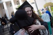 Kaitlyn Batchelor, WC '16, gets a hug after The Women's College commencement on Friday, May 6, 2016, in Gainesville, Ga. (AJ Reynolds/Brenau University)