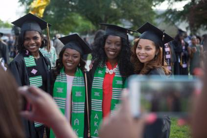 Jordan Pittman, from left, Kierra Herring, Nichele Nibbs and Austalia Beaufait, all members of Alpha Kappa Alpha, pose for photos during The Women's College commencement on Friday, May 6, 2016, in Gainesville, Ga. (AJ Reynolds/Brenau University)