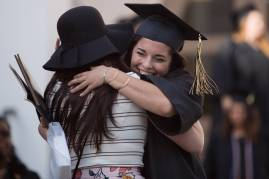 Kayla DelPizzo, WC '16, gets a hug after The Women's College commencement on Friday, May 6, 2016, in Gainesville, Ga. (AJ Reynolds/Brenau University)