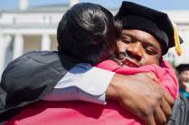 Allen Patmon hugs his girlfriend Kisha Knight after receiving his Occupational Therapy Doctorate during the Brenau University Undergraduate and Graduate Commencement on Saturday, May 7, 2016, in Gainesville, Ga. (AJ Reynolds/Brenau University)