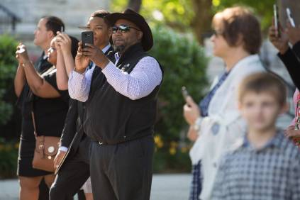 Family and friends take photographs of the processional during the Brenau University Undergraduate and Graduate Commencement on Saturday, May 7, 2016, in Gainesville, Ga. (AJ Reynolds/Brenau University)