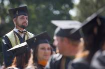 Michael Crouch, BU '16, stands to be recognized as a military veteran during the Brenau University Undergraduate and Graduate Commencement on Saturday, May 7, 2016, in Gainesville, Ga. (AJ Reynolds/Brenau University)