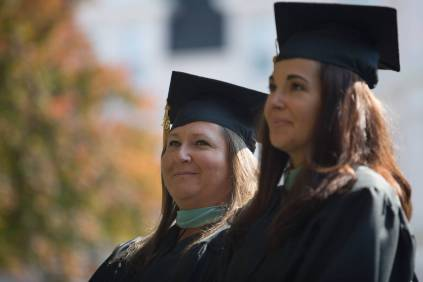 Turrah Benton, BU '16, left, and Jennifer Ryan Ray, BU '16, stand to be conferred Educational Specialist degrees during the Brenau University Undergraduate and Graduate Commencement on Saturday, May 7, 2016, in Gainesville, Ga. (AJ Reynolds/Brenau University)