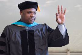 Dr. Allen Patmon, Occupational Therapy Doctorate, walks across the stage during the Brenau University Undergraduate and Graduate Commencement on Saturday, May 7, 2016, in Gainesville, Ga. (AJ Reynolds/Brenau University)