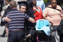 Patrick Condon, BU '16, gets a hug after the Brenau University Undergraduate and Graduate Commencement on Saturday, May 7, 2016, in Gainesville, Ga. (AJ Reynolds/Brenau University)