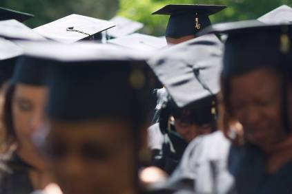 Graduates bow their heads for the benediction during the Brenau University Undergraduate and Graduate Commencement on Saturday, May 7, 2016, in Gainesville, Ga. (AJ Reynolds/Brenau University)
