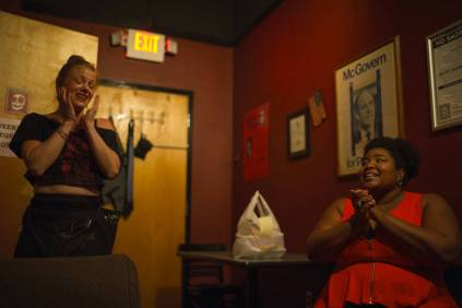 Dulcé Sloan, WC '05, reacts after learning that her performance on Conan was aired at The Laughing Skull Lounge and The Vortex. Sloan remains friends with many of the other performers and staff at the Laughing Skull from her time in Atlanta. (AJ Reynolds/Brenau University)