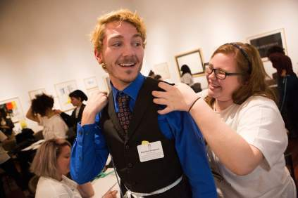 Brandon Thompson, center, and Alex Foster laugh while practicing taking measurements during The Art of Costume Design workshop presented by Diana Eden. (AJ Reynolds/Brenau University)