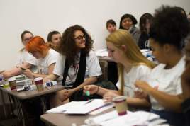 Students smile during a lecture during The Art of Costume Design workshop presented by Diana Eden. (AJ Reynolds/Brenau University)