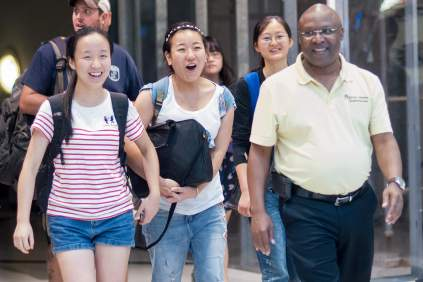 From left, Crystal Wang, Cathy Wu, Daisy Qiu and College of Education Dean Eugene Williams walk into the arrivals area at Hartsfield-Jackson International Airport in Atlanta. (AJ Reynolds/Brenau University)