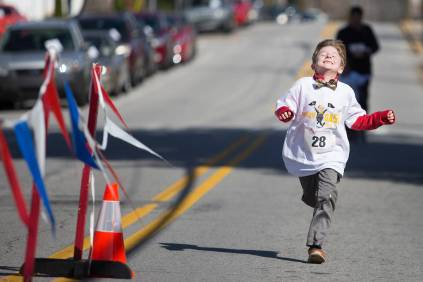 Maddox Dempsey reacts while crossing the finish line during the Dempsey Dash 5K, a race celebrating the memory of Brenau's longtime Executive Vice President and CFO Wayne Dempsey, on Saturday, March 11, 2017. (AJ Reynolds/Brenau University)