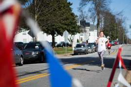 Xin 'Daisy' Qiu crosses the finish line during the Dempsey Dash 5K, a race celebrating the memory of Brenau's longtime Executive Vice President and CFO Wayne Dempsey, on Saturday, March 11, 2017. (AJ Reynolds/Brenau University)