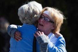 Nita Tammarine hugs Marsha Dempsey during the Dempsey Dash 5K, a race celebrating the memory of Brenau's longtime Executive Vice President and CFO Wayne Dempsey, on Saturday, March 11, 2017. (AJ Reynolds/Brenau University)