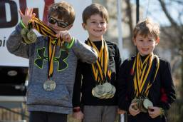 Will Dempsey, Maddox Dempsey and Cooper Dempsey present the medals after the Dempsey Dash 5K, a race celebrating the memory of Brenau's longtime Executive Vice President and CFO Wayne Dempsey, on Saturday, March 11, 2017. (AJ Reynolds/Brenau University)
