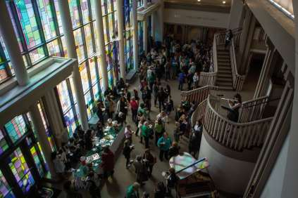 Attendees gather in the lobby of the John S. Burd Center for the Performing Arts for a tea break during the 4th Annual Women's Leadership Colloquium on Friday, March 17, 2017. (AJ Reynolds/Brenau University)