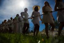 A group of juniors carry the daisy chain toward the Crow's Nest for Class Day. (AJ Reynolds/Brenau University)