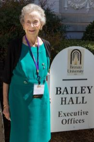 Cathryn V. Cook, WC '49 poses for a photo by the Bailey Hall sign. During her time at Brenau, Cook lived in the hall. (AJ Reynolds/Brenau University)