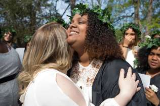 Hannah Vigil-Shuck, a rising senior, gets a hug from Sara Hubaishi, a graduating senior, after ascending the Crow's Nest. (AJ Reynolds/Brenau University)