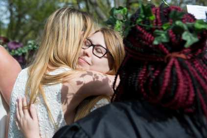 Amber Stowers get a hug from Connie Oldmizon on top of the Crow's Nest. (AJ Reynolds/Brenau University)