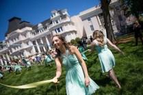 Mary Rose Gibson, left, and Hannah Vigil-Shuck,right, wrap the Maypole. (AJ Reynolds/Brenau University)