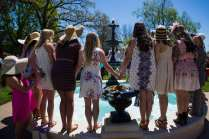 Students and alumnae from Phi Mu gather around the Grace Hooten Moore Memorial Fountain to celebrate the engagement of their sorority sister Savannah Romans. (AJ Reynolds/Brenau University)