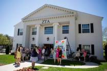 Alumnae and current students gather and mingle outside the Zeta Tau Alpha sorority house. (AJ Reynolds/Brenau University)