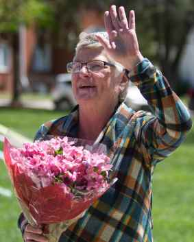 In honor of her retirement, Debbie Thompson received her own tiara and flowers at this year's May Day celebration, given to her by Amari Banks, left. (AJ Reynolds/Brenau University)