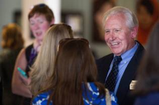 Dr. Vince Yamilkoski chats with attendees during a reception honoring his 38 years of service to Brenau University. (AJ Reynolds/Brenau University)