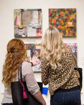 Ashley Motes, left, explains her piece to an attendee during the Brenau Collaborative Opening Reception. (AJ Reynolds/Brenau University)