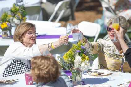 Susan Sperry Cage, WC '67, toasts with Jennie Gaines Caldwell, WC '67, during the Champagne Brunch. (AJ Reynolds/Brenau University)