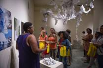 A crowd gathers as Britney Powe discusses her work during the Brenau Collaborative Opening Reception. (AJ Reynolds/Brenau University)