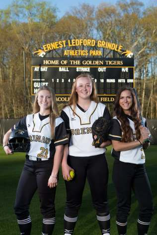From left to right Mason Garland, a junior from Hoschton, Ga., Eli Daniel, a freshman from Locust Grove, Ga., and Mackenzie Oliver Mullis, a senior from Carnesville, Ga., pose for a photo at Pacolet Milliken Field at the Ernest Ledford Grindle Athletics Park. (AJ Reynolds/Brenau University)
