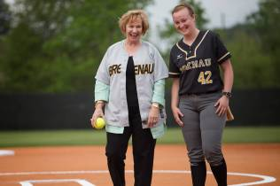 Kay Ivester smiles with Brenau pitcher Eli Daniel before throwing out the ceremonial first pitch during the celebration of the opening season of Pacolet Milliken Field at the Ernest Ledford Grindle Athletics Park, named for Kay Ivester's father. (AJ Reynolds/Brenau University)