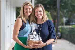 Brooke Bargeron Statham, WC '00, presents Amber Simmons, WC '03, with the Professional Achievement Award as part of the Alumni Awards during the homecoming celebrations at Brenau University. (AJ Reynolds/Brenau University)