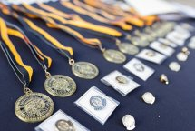 Awards on display for each 5 year reunion, including medals for all 50 year alumnae. (AJ Reynolds/Brenau University)