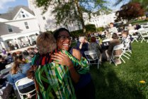 Darnisha Coverson, WC '12, gets a hug from Debbie Thompson at the Reunion on the Lawn. (AJ Reynolds/Brenau University)