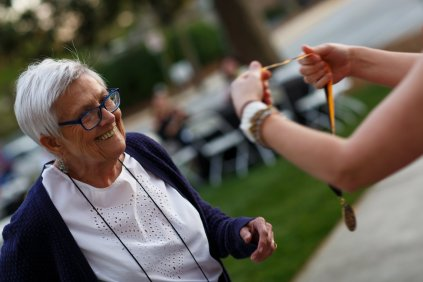 Patricia Fargason, WC '68, perpares to be pinned for her 50th reunion. (AJ Reynolds/Brenau University)