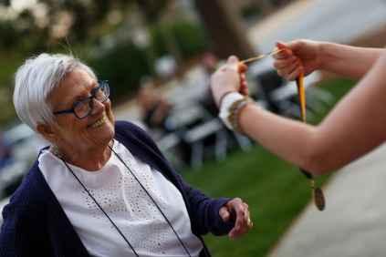 Patricia Fargason, WC '68, perpares to be pinned for her 50th reunion. (AJ Reynolds/Brenau University)