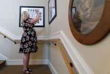 Logan Life, WC '09, takes a photo of her Alpha Delta Pi class composite inside the sorority house. (AJ Reynolds/Brenau University)