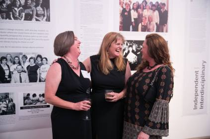 Professor of Interior Design Lynn Jones, center, poses for a photograph with friends Jane Wall Coley, left, and Robin Ricks Fouts during the Interior Design Retrospective at the Burd Center for the Performing Arts at Brenau University Saturday, April 14, 2018, in Gainesville, Ga. Photo by Jason Getz / Brenau University