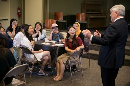 Brenau University President Ed Schrader speaks to the ANU-Brenau University students during a luncheon at Brenau University Friday May 4, 2018 in Gainesville, Ga. (Jason Getz for Brenau University)