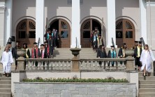 The students walk down the steps during the processional to start the Women's College Commencement at Brenau University Friday May 4, 2018 in Gainesville, Ga. (Jason Getz for Brenau University)