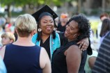 Graduate Shequonna Holden, center, celebrates with her mother Rosheenah Oglesby, of Toccoa, at the conclusion of the Women's College Commencement at Brenau University Friday May 4, 2018 in Gainesville, Ga. (Jason Getz for Brenau University)